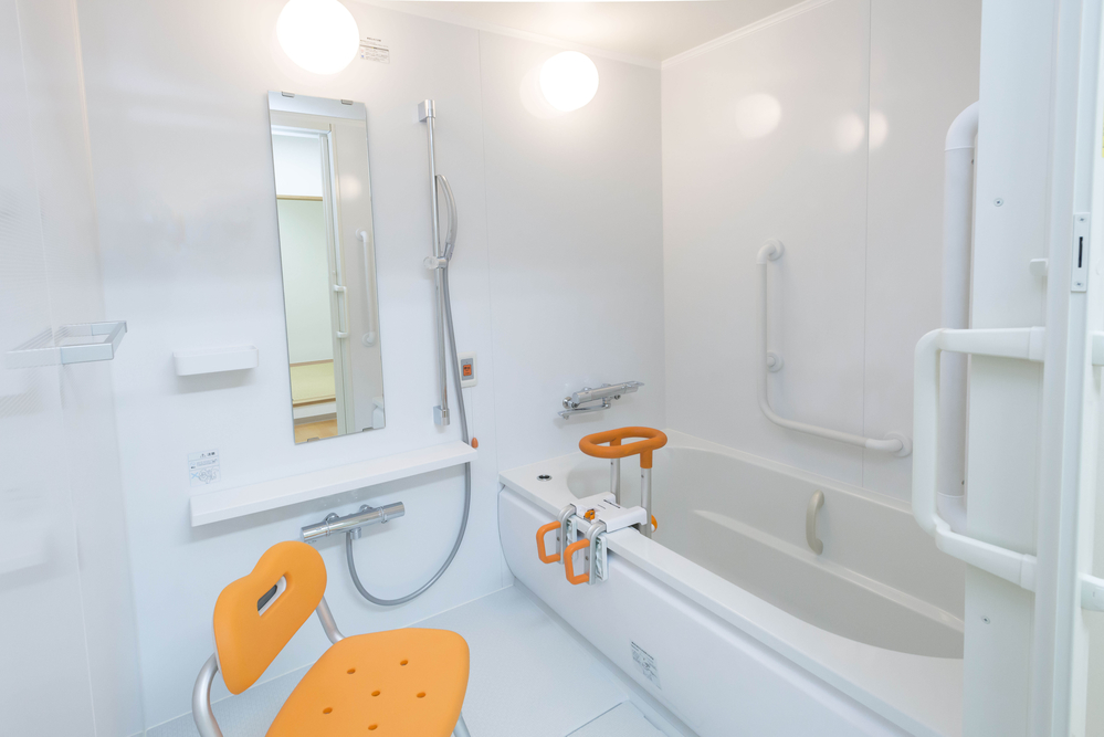 Safety items in a white bathroom.