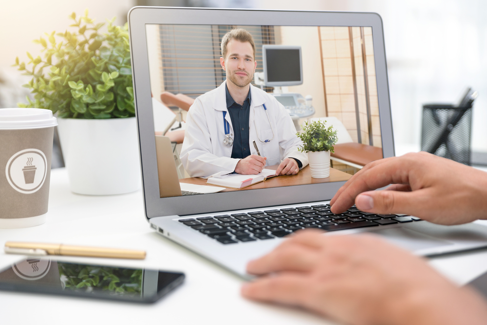 A telemedicine appointment on a laptop.